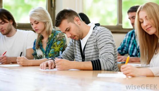 adult-classmates-at-desk-writing.jpg